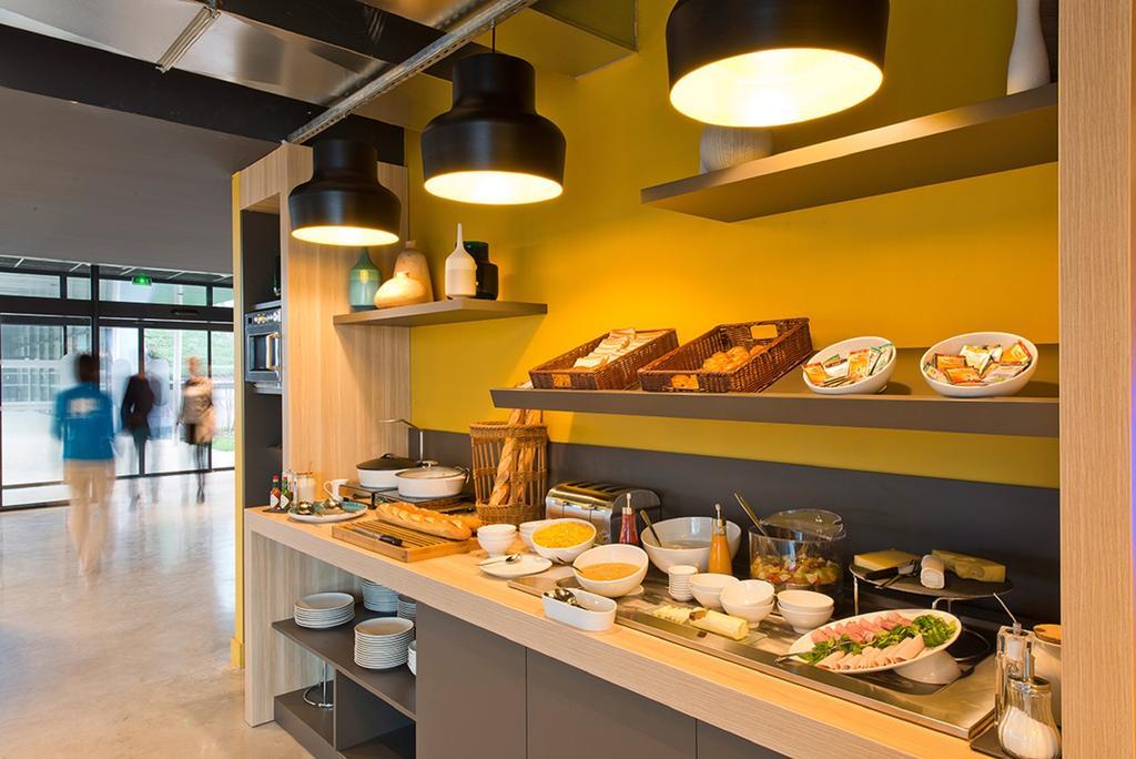 desayuno del hotel Nomad Paris Roissy CDG en París
