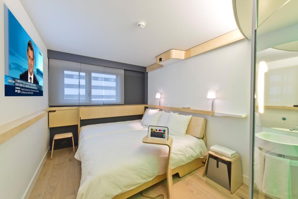 habitación del hotel Nomad Paris Roissy CDG en París