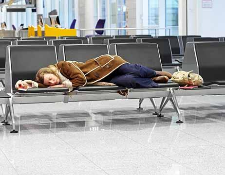 Woman sleeping in airport